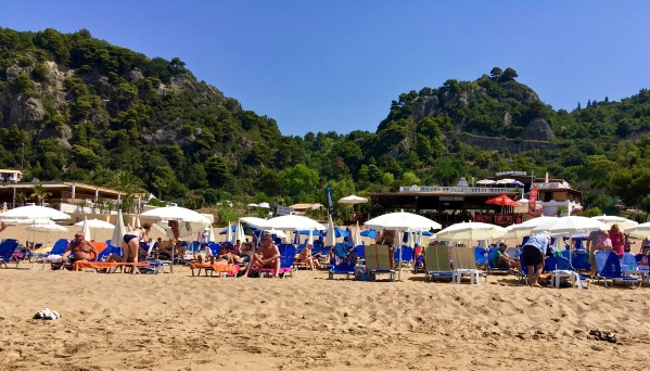 The cafe overlooking the beach with lots of umbrellas outside for shade on the sun beds