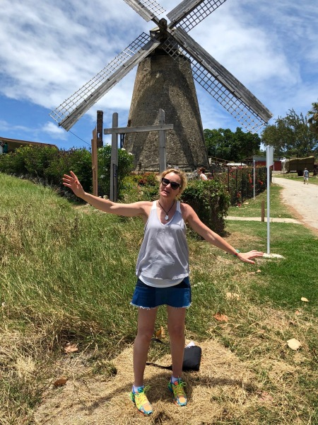 Sarah stood in front of the windmill moving her arms to the sails of the windmill