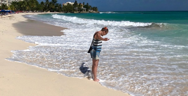 Sarah cooling her feet in the sea at dover beach