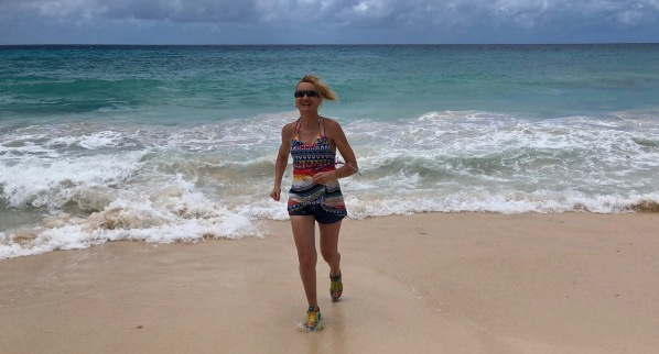 Sarah running on Barbados beach