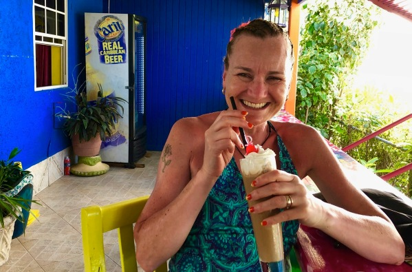 Sarah sat with an iced coffee in the very colourful Sharkey's Tropical Cafe